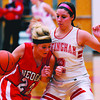 Effingham's Kelli Utz guards Neoga's Kristin Deters on at the Effingham Tournament.
