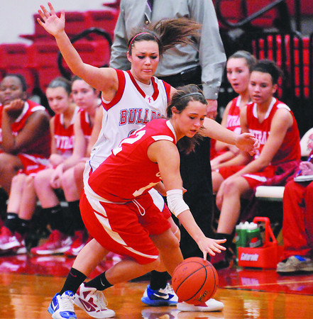 St. Anthony's Makayla Walsh guards Centralia's Raigen Schwartz at Effingham High School.