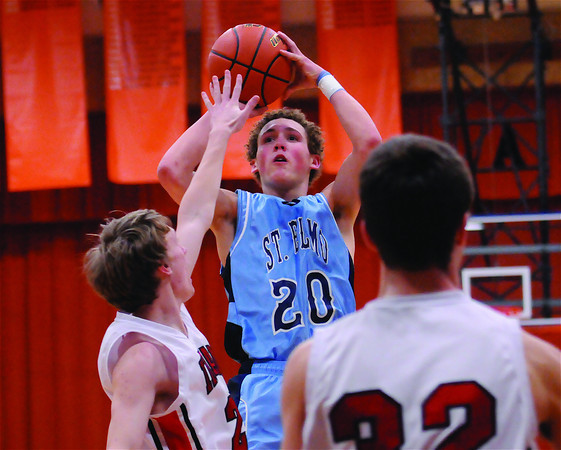 St. Elmo's Levi Maxey shoots over two defenders from Neoga at the NTC tournament.
