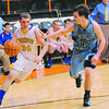 Cowden-Herrick's Tyson Morgason drives past St. Elmo's Reese Wells in the quarterfinals of the NTC tournament.
