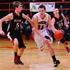 Neoga's Jake Baker brings the ball up court while being pressured by Beecher City's Blake McKay (5) and Doug Krueger (35) at the NTC tournament in Altamont.
