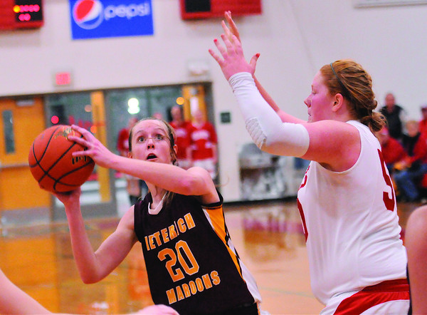 Dieterich's Candace Niemerg goes for a head fake against Centralia's Abbey HoltkampTuesday at the Effingham Tournament.