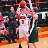 Altamont's Garrett Ziegler puts up a jump shot while being defended by a player from Stewardson-Strasburg at the NTC tournament.