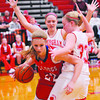 St. Anthony's Kate Richards attempts to get around Effingham's Caitlin Kaufman (33) and another Hearts defender at the Effingham Tournament.