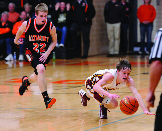 Dieterich's Dalton Hinterscher dives for a loose ball while Altamont's Cole Borders gives chase.