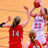 St. Anthony's Makayla Walsh rises up for a jump shot while being defended by Neoga's E.C. Thies (14) and Jillian Deters (20) Thursday night at the Enlow Center. Walsh had 14 points for the Bulldogs' victory win.