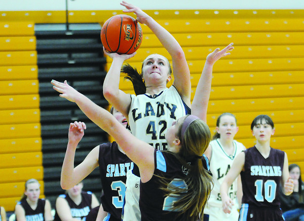 Teutopolis' Madeline Hartke draws contact from a St. Joseph Ogden defender while going up for a shot in the Lady Shoes' 49-37 win over the Spartans. Hartke led all scoers with 19 points.