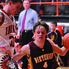 Dieterich's Dalton Hinterscher drives around Altamont's Jon Kuhns. Hinterscher had 37 points in the Maroons' victory against the Indians.