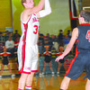 Effingham's Hunter Keith looks for an open teammate against Mt. Vernon in the Salem Invitational Tournament.