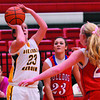 Dieterich's Katilyn Meinhart shoots a jumper while being defended by St. Anthony's Makayla Walsh (center) and Megan Nuxoll (right).