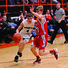 Stew-Stras' Brandon Helmuth takes the ball into the lane while being defended by St. Anthony's Neil WIlliams at the NTC tournament.