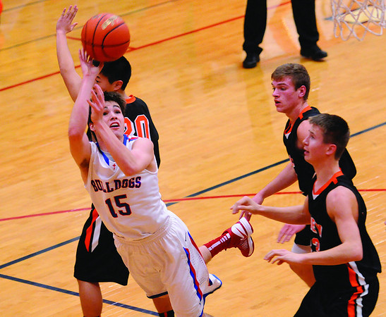 St. Anthony's Jacob Schuette slices to the basket for two of his 25 points in the Bulldogs' 66-56 loss to Olney at the St. Anthony Shootout.