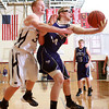 1-17-14<br /> Boys County Tourney Western vs. Northwestern<br /> Western's Zach Shahan and Northwestern's Keagan Downey go after a rebound.<br /> KT photo | Kelly Lafferty