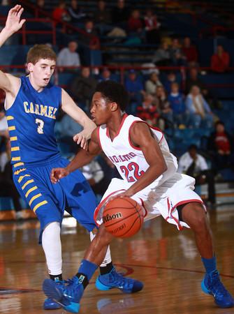 1-18-14<br /> Kokomo vs. Carmel basketball<br /> Kokomo's Jeron Gray dribbles around Carmel's Ryan Cline.<br /> KT photo | Kelly Lafferty