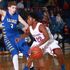 1-18-14<br /> Kokomo vs. Carmel basketball<br /> Kokomo's Jeron Gray dribbles around Carmel's Ryan Cline.<br /> KT photo | Kelly Lafferty