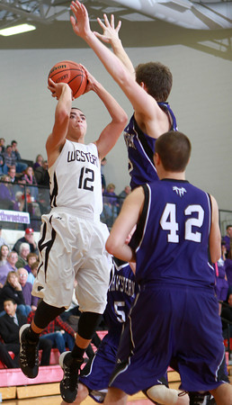 1-17-14<br /> Boys County Tourney Western vs. Northwestern<br /> Western's Des Balentine shoots.<br /> KT photo | Kelly Lafferty