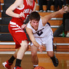 1-3-14<br /> Northwestern boys basketball<br /> Twin Lakes' Cody DeBoy and Northwestern's Blaine Brutus run after a loose ball.<br /> KT photo | Kelly Lafferty
