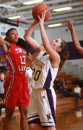 1-3-14<br /> Northwestern girls basketball<br /> Northwestern's Sydney Zeck goes for a shot as Twin Lakes Laurhen Pickett tries to block it.<br /> KT photo | Kelly Lafferty