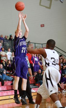 1-17-14<br /> Boys County Tourney Western vs. Northwestern<br /> Northwestern's Graham Ortmann shoots.<br /> KT photo | Kelly Lafferty