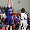 1-17-14<br /> Boys County Tourney Western vs. Northwestern<br /> Northwestern's Graham Ortmann shoots.<br /> KT photo | Kelly Lafferty