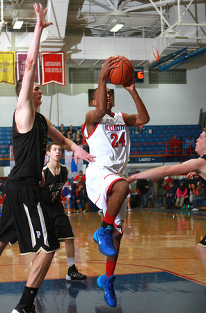 1-4-14<br /> Kokomo vs. Peru bball<br /> Kokomo's Mykal Cox goes for a shot as he tries to get past Peru's defense.<br /> KT photo | Kelly Lafferty