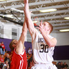 1-22-14<br /> Western vs. Taylor bball<br /> Western's Zach Shahan shoots over Taylor's defense.<br /> KT photo | Kelly Lafferty