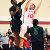 1-8-14<br /> IUK bball vs. SIU<br /> IUK's Aaron Knupp shoots above SIU's Walter Brock.<br /> KT photo | Kelly Lafferty