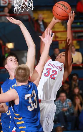 1-18-14<br /> Kokomo vs. Carmel basketball<br /> Jordan Matthews tries to get a shot over Carmel's defense.<br /> KT photo | Kelly Lafferty