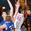1-18-14<br /> Kokomo vs. Carmel basketball<br /> Jordan Matthews tries to get a shot over Carmel's defense.<br /> KT photo | Kelly Lafferty