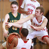 1-17-14<br /> Boys County Tourney Taylor vs. Eastern<br /> Eastern's Noah Cope, and Taylor's Calvin Wheeler and Cole Schroeder scramble after a loose ball.<br /> KT photo | Kelly Lafferty