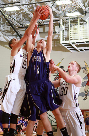 1-17-14<br /> Boys County Tourney Western vs. Northwestern<br /> Western's Des Balentine, Northwestern's Tyler Hudson, and Western's Zach Shahan go after a rebound.<br /> KT photo | Kelly Lafferty