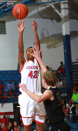 1-4-14<br /> Kokomo vs. Peru bball<br /> Kokomo's Demarius Warren shoots the ball during the game against Peru.<br /> KT photo | Kelly Lafferty