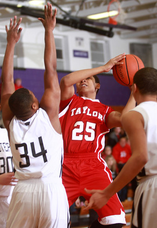 1-22-14<br /> Western vs. Taylor bball<br /> Taylor's Latrell Mitchell tries to shoot over Western's defense.<br /> KT photo | Kelly Lafferty