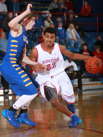 1-18-14<br /> Kokomo vs. Carmel basketball<br /> Kokomo's Jordan Matthews dribbles around Carmel's Ryan Cline.<br /> KT photo | Kelly Lafferty