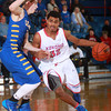 1-18-14<br /> Kokomo vs. Carmel basketball<br /> Kokomo's Jordan Matthews dribbles around Carmel's Ryan Cline.<br /> KT photo | Kelly Lafferty