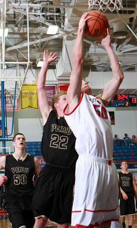 1-4-14<br /> Kokomo vs. Peru bball<br /> Kokomo's Erik Bowen goes for a shot as Peru's Austin Finicle tries to stop him.<br /> KT photo | Kelly Lafferty
