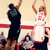 1-8-14<br /> IUK bball vs. SIU<br /> IUK's Jerome Campbell tries to shoot above SIU's Abel Tillman.<br /> KT photo | Kelly Lafferty