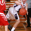 1-3-14<br /> Northwestern boys basketball<br /> Keagan Downey makes a pass just before going out of bounds.<br /> KT photo | Kelly Lafferty