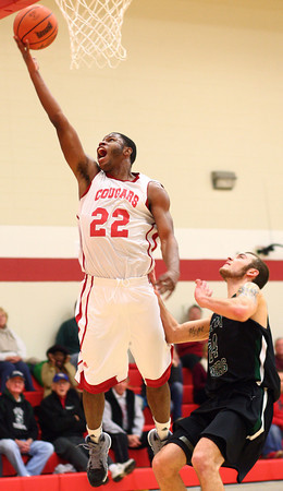 1-8-14<br /> IUK bball vs. SIU<br /> David Kelly makes a basket for IUK.<br /> KT photo | Kelly Lafferty