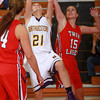 1-3-14<br /> Northwestern girls basketball<br /> Kaitlyn Daanen of Northwestern goes for a shot and Twin Lakes Gabrielle Kendall tries to block it.<br /> KT photo | Kelly Lafferty