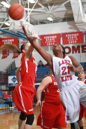 1-11-14<br /> Kokomo High School girls basketball<br /> Kokomo's Schnetavia Williams goes for the basket as Richmond's Mackenzie Taylor tries to block her.<br /> KT photo | Kelly Lafferty