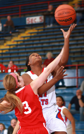 1-11-14<br /> Kokomo High School girls basketball<br /> Kokomo's Schnetavia Williams goes for the basket as Richmond's Bailey Hillard tries to block her.<br /> KT photo | Kelly Lafferty