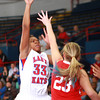 1-11-14<br /> Kokomo High School girls basketball<br /> Kokomo's Gabrielle Smith shoots as Richmond's Hannah Goddard tries to block her.<br /> KT photo | Kelly Lafferty