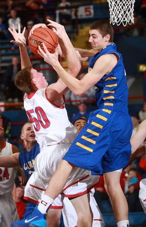 1-18-14<br /> Kokomo vs. Carmel basketball<br /> Kokomo's Erik Bowen and Carmel's Zach McRoberts go after a rebound.<br /> KT photo | Kelly Lafferty