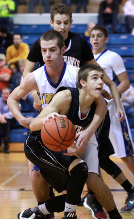 1-14-14<br /> Tri Central vs. Sheridan basketball<br /> Tri Central's Bryce Dowell tries to get the ball away from Sheridan's Jake Chesney.<br /> KT photo | Kelly Lafferty