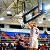 Newton's Luke Stone watches a layup go in to the basket during a Newton game against Casey-Westfield.