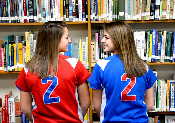 Lauren Ohnesorge (left) and Madison Ohnesorge (right) wear new jerseys from Lincoln Land Community College after their signing ceremony at Altamont High School.