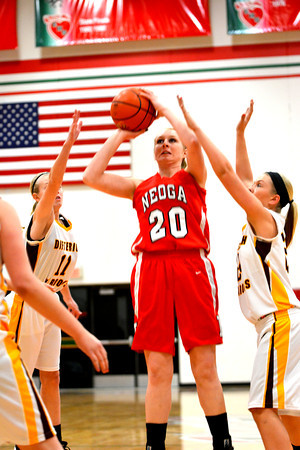 Neoga's Jillian Deters takes a jump shot while Dieterich's Courtney Flach (left) and Dieterich's Kallee Heuerman (right) attempt to contest the shot.