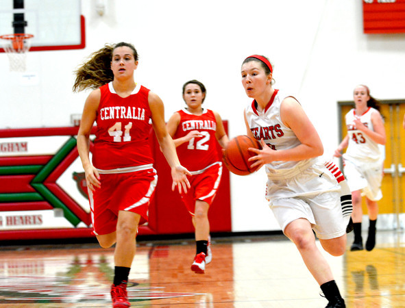 Effingham's Jantzen Michael prepares to throw a bounce pass while on a fast break during the Lady Hearts' win against Centralia.