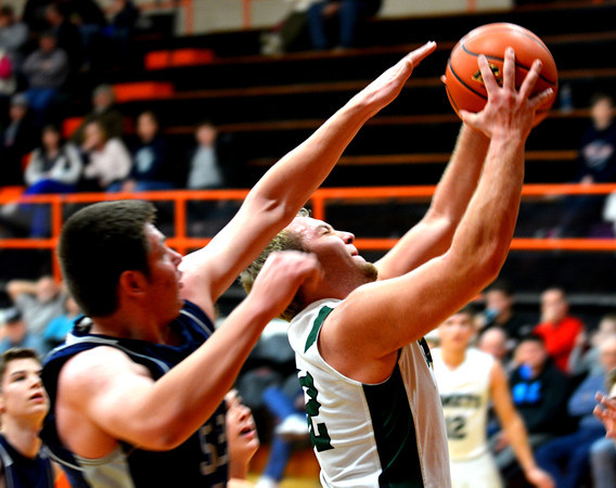 Stew-Stras' Jason Fry goes for a layup while a South Central defender attempts to block the shot.